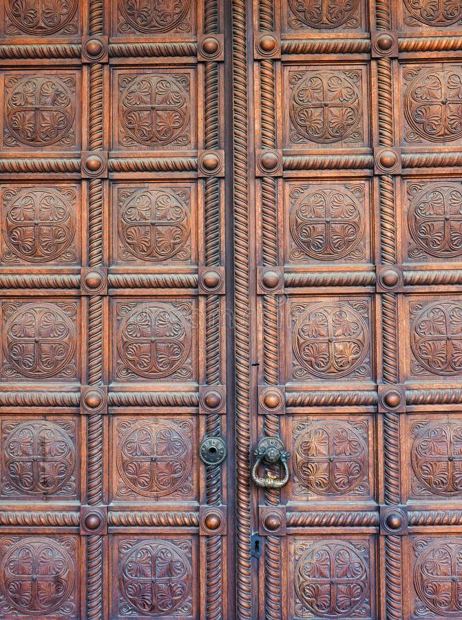 Polished Heavy Wooden Church Doors, Alexander Nevsky Cathedral, Sofia, Bulgaria. Polished heavy wooden main doors to the historic Alexander Nevsky Bulgarian royalty free stock photo