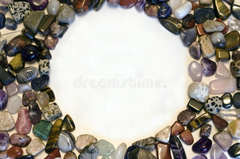 Polished stones. A circle formed by polished stones with a centre for lettering royalty free stock images