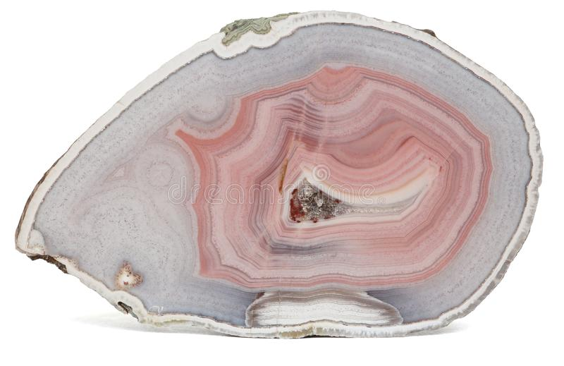 Agate specimen. Polished specimen of agate, a variety of chalcedony, isolated on a white background royalty free stock photo