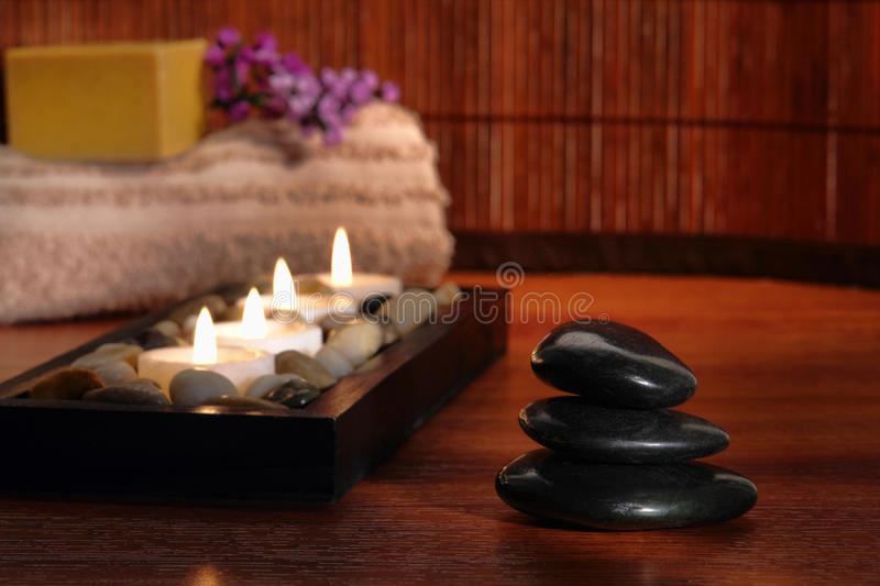 Polished Stone Cairn and Candles in Relaxation Spa stock photos