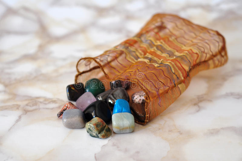 Polished stones. Small polished colorful stones in bag royalty free stock images