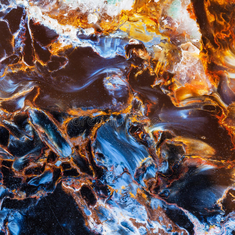 Polished surface of petersite gem stone close up stock images