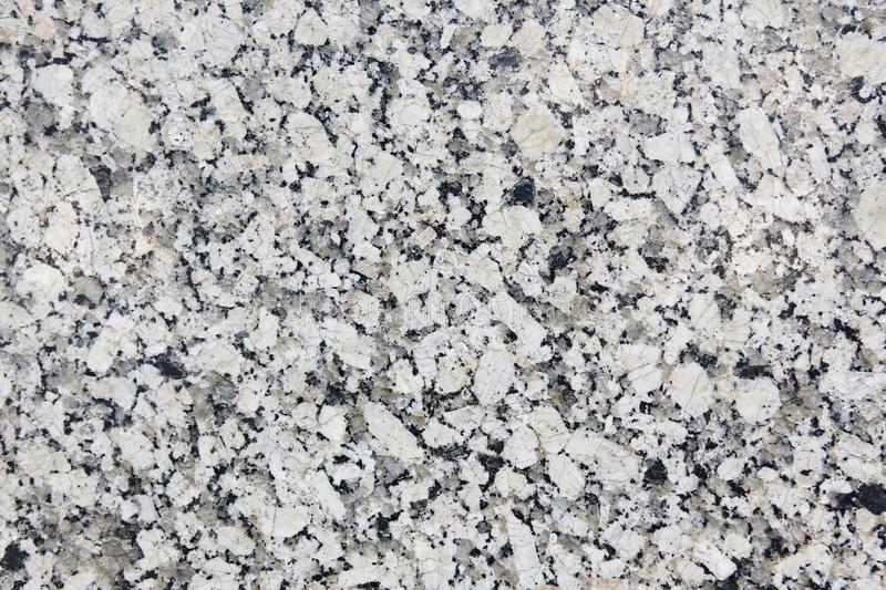 Polished white and grey granite surface. Mineral background. Con stock photo