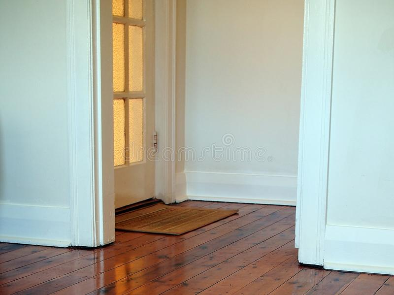Polished Wood Floor. And white framed doorway stock images