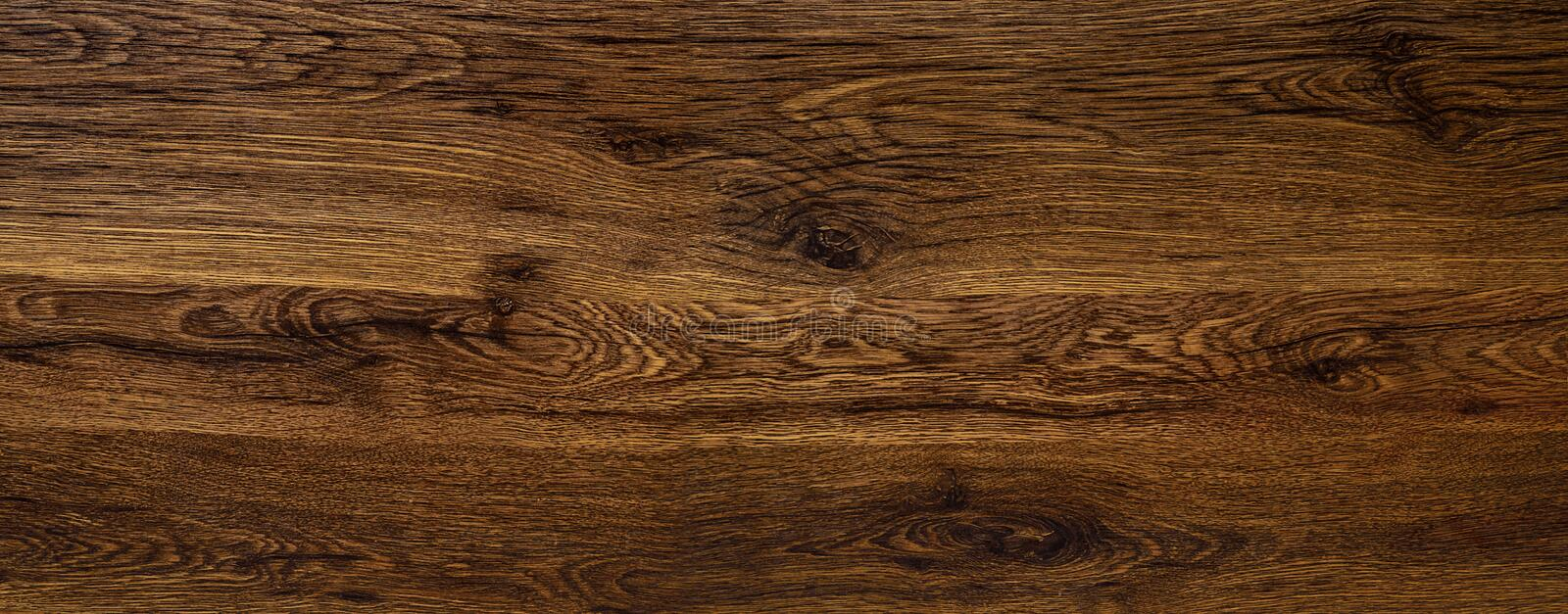 Polished wood surface. The background of polished wood texture royalty free stock images