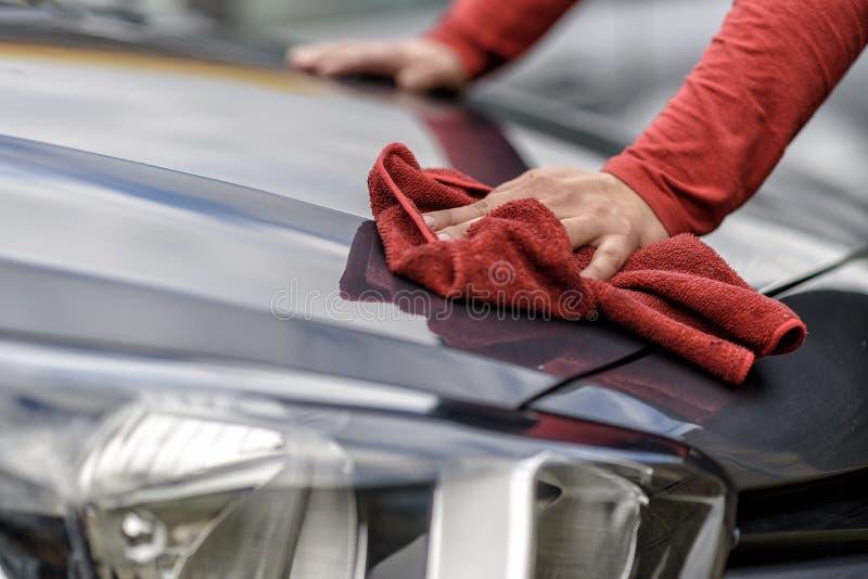Polishing a car after the car wash. Polishing a car with a rag after the car wash stock images