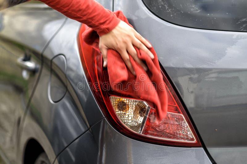 Polishing a car after the car wash. Polishing a car with a rag after the car wash stock photography