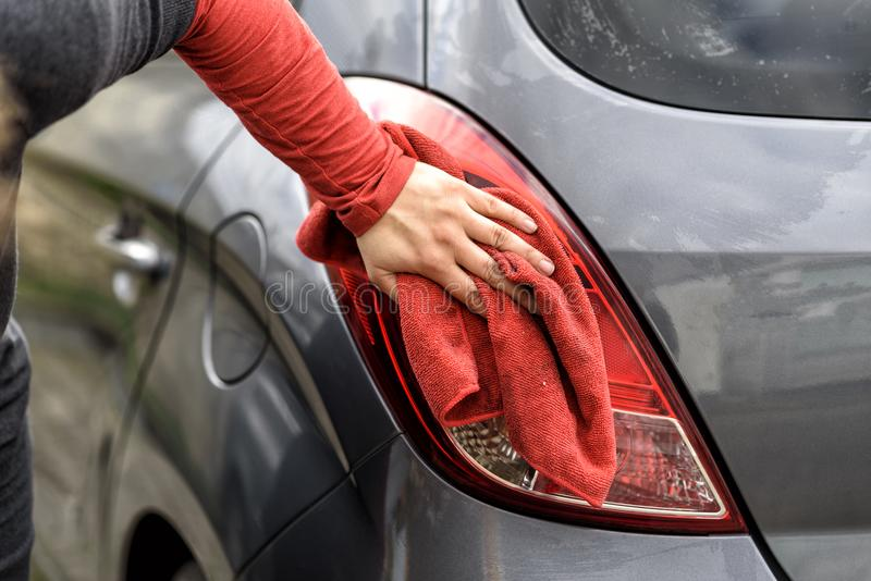 Polishing a car after the car wash. Polishing a car with a rag after the car wash royalty free stock image