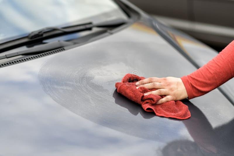 Polishing a car after the car wash. Polishing a car with a rag after the car wash stock image