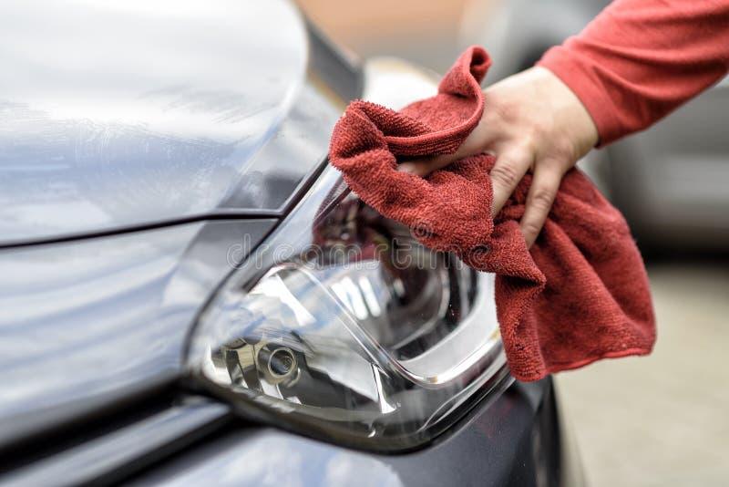 Polishing a car after the car wash. Polishing a car with a rag after the car wash royalty free stock photo