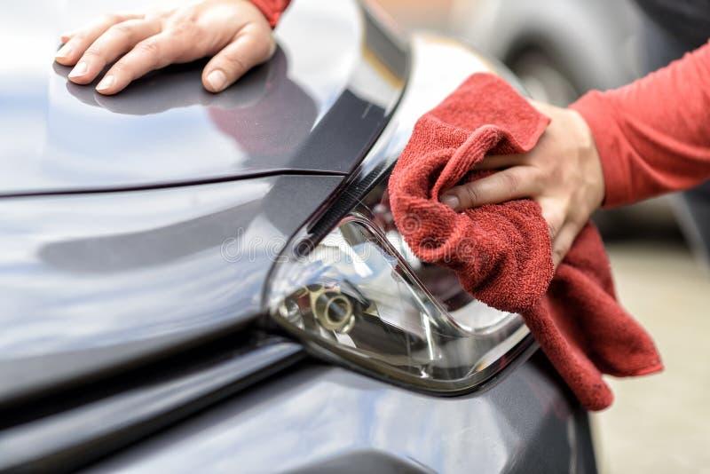 Polishing a car after the car wash. Polishing a car with a rag after the car wash stock photos