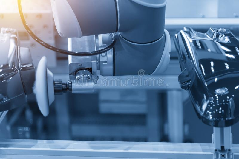 The polishing robot the automotive factory. In the light blue scene.Hi-technology for automotive industry stock photography