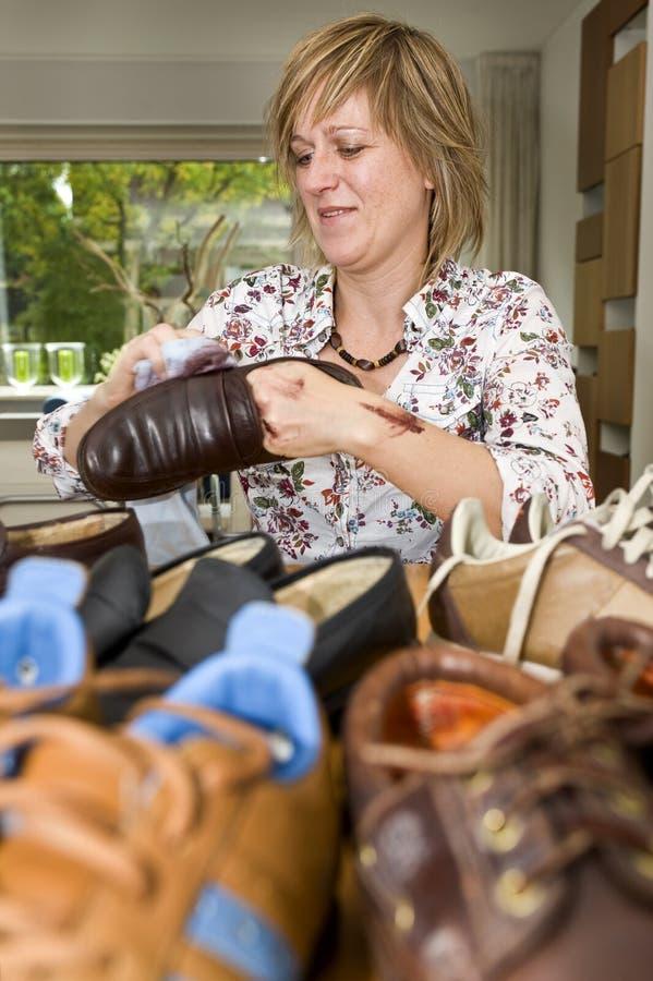 Polishing shoes royalty free stock image