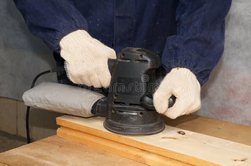 Polishing the wood stock photo