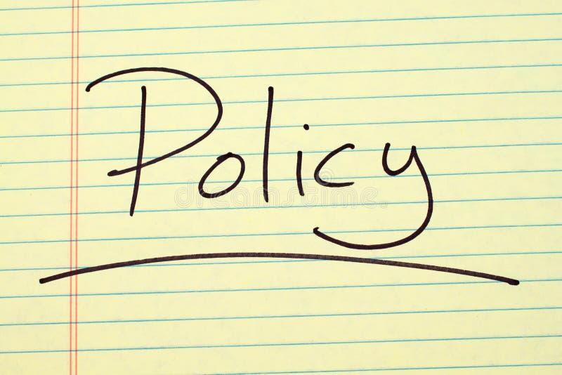 Politica su un blocco note giallo fotografie stock libere da diritti