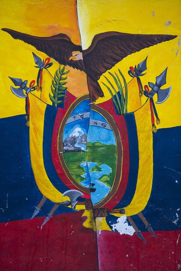 Political graffiti in Otavalo, flag and American Bald Eagle. OTAVALO, ECUADOR - FEB 28, 2015: Graffiti on wall, composition of Ecuador flag and American Bald royalty free stock images