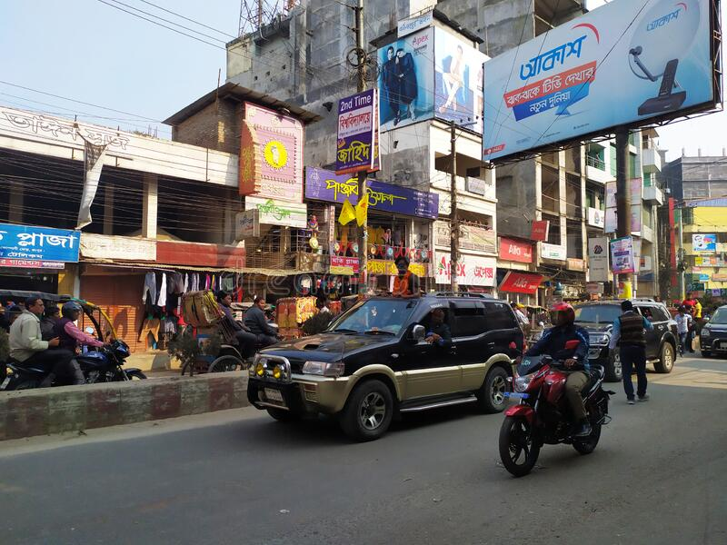 Political leader. Mayor of Rangpur City with his Government Car. City Street with A lots of people.Administration of Bangladesh at. Rangpur city stock photography