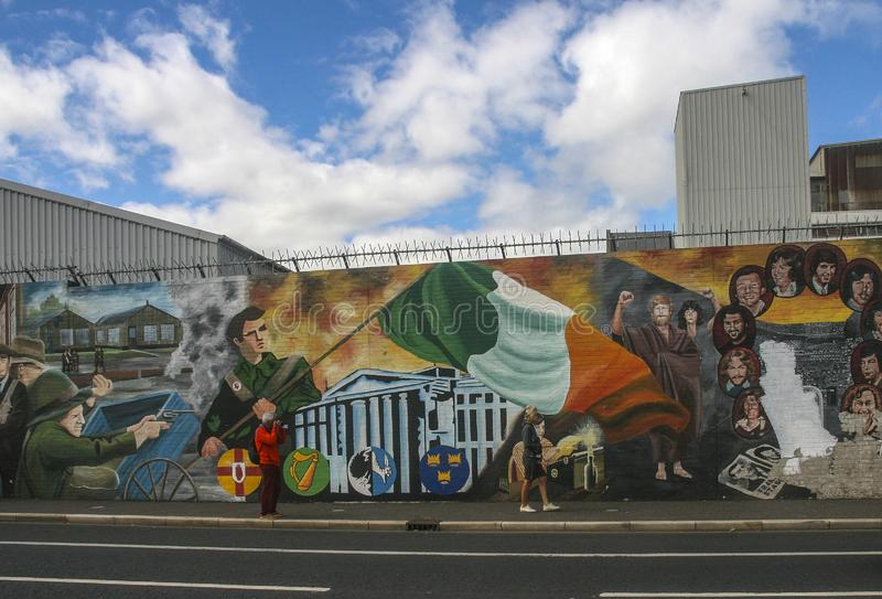 Political mural and peace wall in belfast,northern ireland stock image
