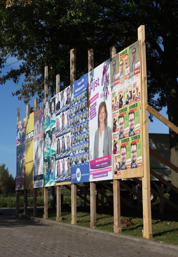 Political Posters, Elections Flanders, Belgium. AALST, BELGIUM, 9 OCTOBER 2018: A billboard full of political candidates posters for the local elections in stock image