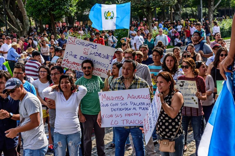 Political protests, Antigua, Guatemala. Antigua, Guatemala - September 15, 2017: Locals wave Guatemalan flags & slogans protesting against government corruption royalty free stock photos