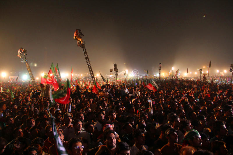 Political Rally Crowd. LAHORE, PAKISTAN - OCT 30: Hundreds of thousands people gather at Minar-e-Pakistan during a political rally of cricketer turned politician royalty free stock image