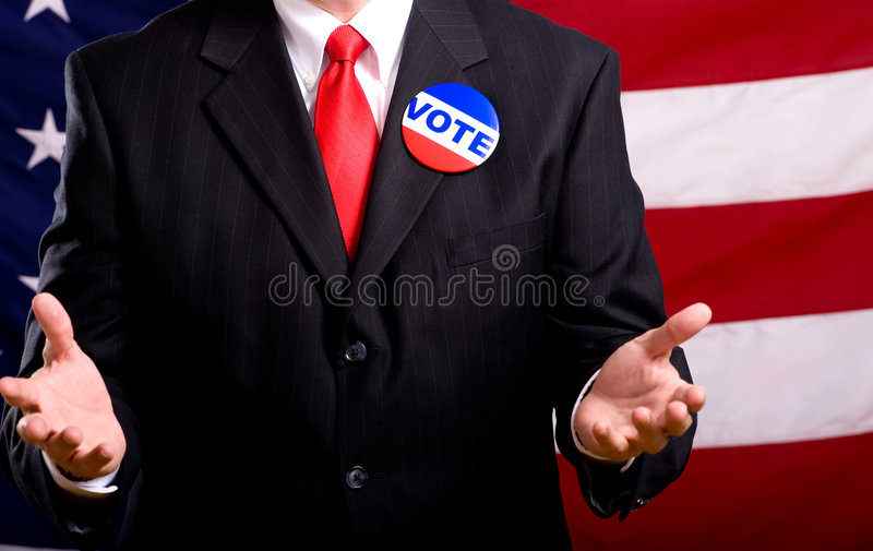 Politician. A politician or business man standing in front of an American flag stumping or pleading with people to vote, exercise priviledge as an Amercan royalty free stock images