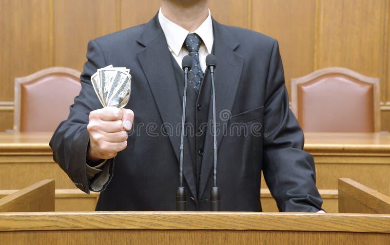 Politician holding money. (dollar bills)political concept,political metaphors, bribery concept stock photography