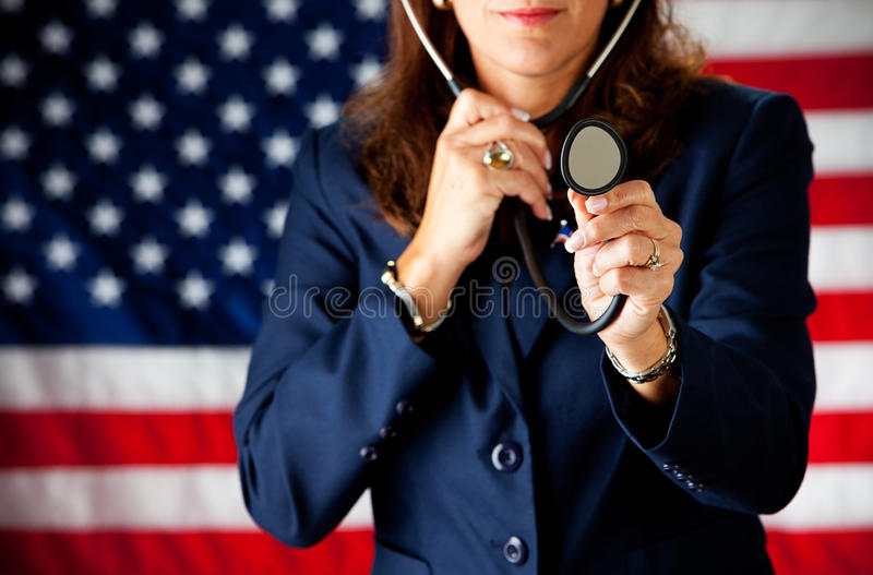 Politician: Playing Doctor with Stethoscope. Series with an adult female in a suit, playing the part of a United States politician. Different props provide a royalty free stock photography
