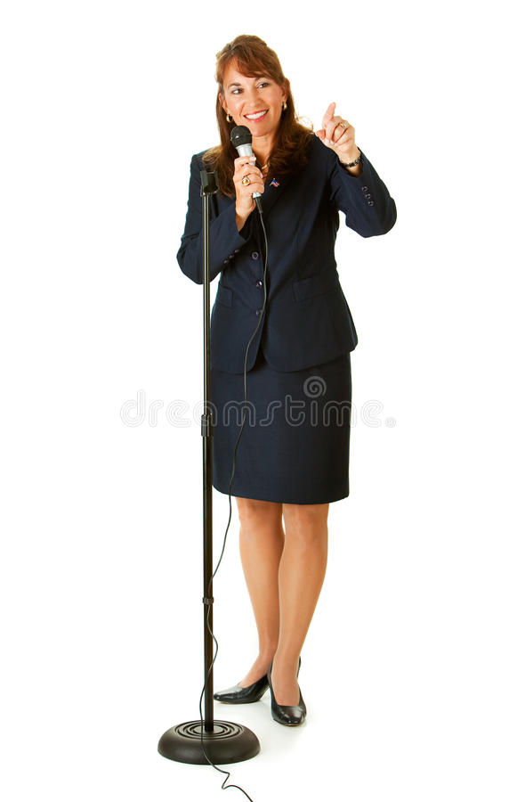 Politician:. Series with an adult female in a suit, playing the part of a United States politician. Different props provide a variety of concepts. Isolated on a royalty free stock photography
