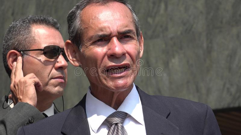 Politician Speaking And Bodyguard stock photo