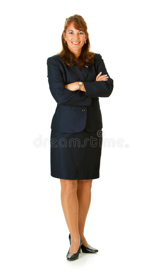 Politician: Standing with Arms Crossed. Series with an adult female in a suit, playing the part of a United States politician. Different props provide a variety stock image