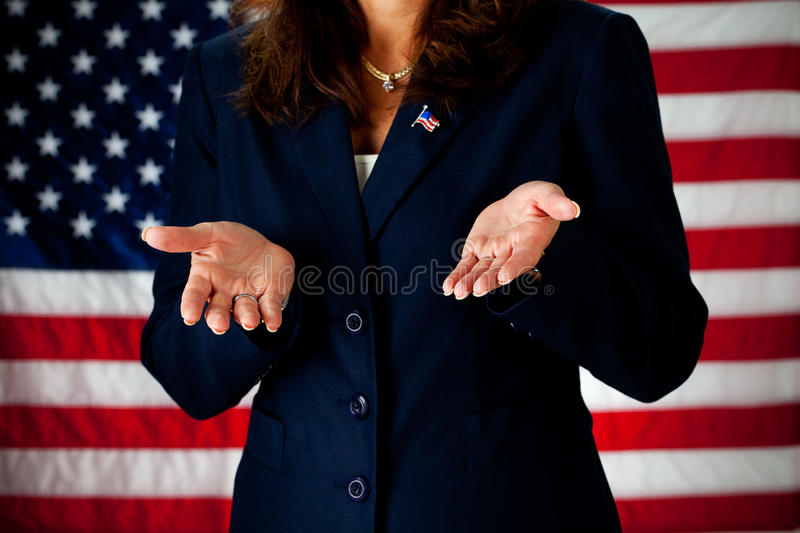 Politician: Welcoming Hands. Series with an adult female in a suit, playing the part of a United States politician. Different props provide a variety of concepts stock images