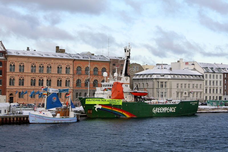 Politicians talk, leaders act - COP15 2009. Greenpeace's boat Arctic Sunrise bearing the message Politicians talk, leaders act. As seen in Copenhagen, December stock photo