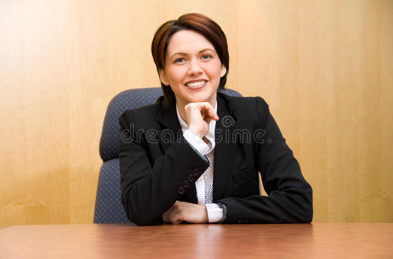 Politics. Happy business woman in a boardroom table stock photos
