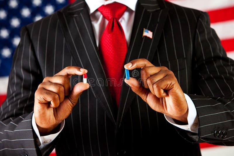 Politicus: De Rode Pil of de Blauwe Pil stock foto's