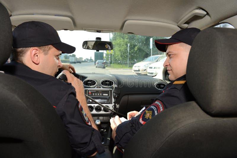 Politie in de patrouillewagen royalty-vrije stock foto's
