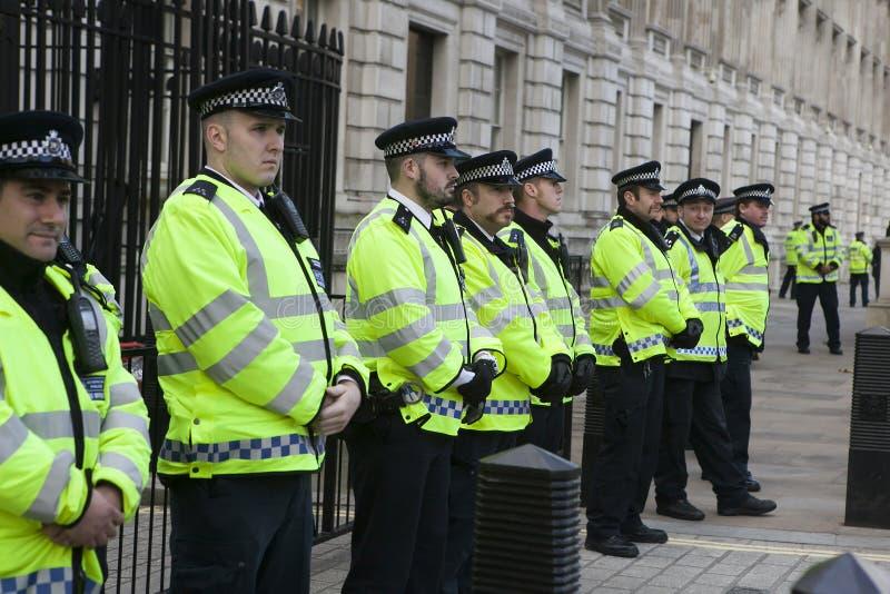 Politie op het protest Maart stock foto