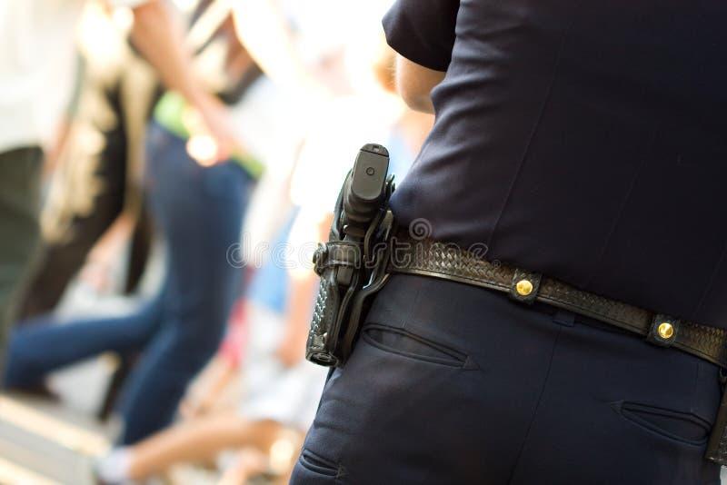 Politieagent in eenvormig stock afbeeldingen