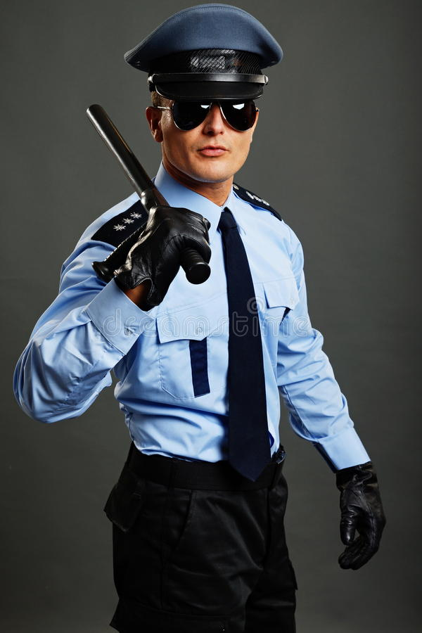 Politieagent met knuppel royalty-vrije stock foto