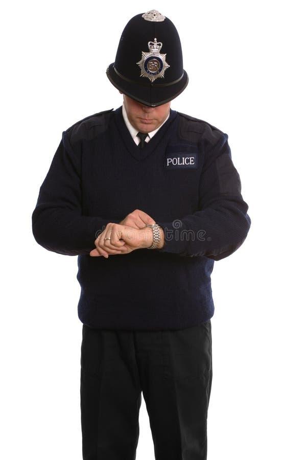 Politieagent timecheck. royalty-vrije stock afbeeldingen