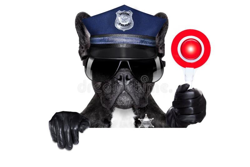 Politieagenthond met eindeteken stock afbeelding