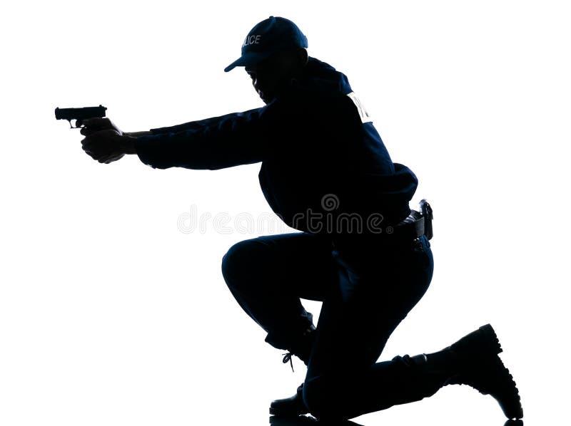 Politieman die kanon streeft royalty-vrije stock foto's