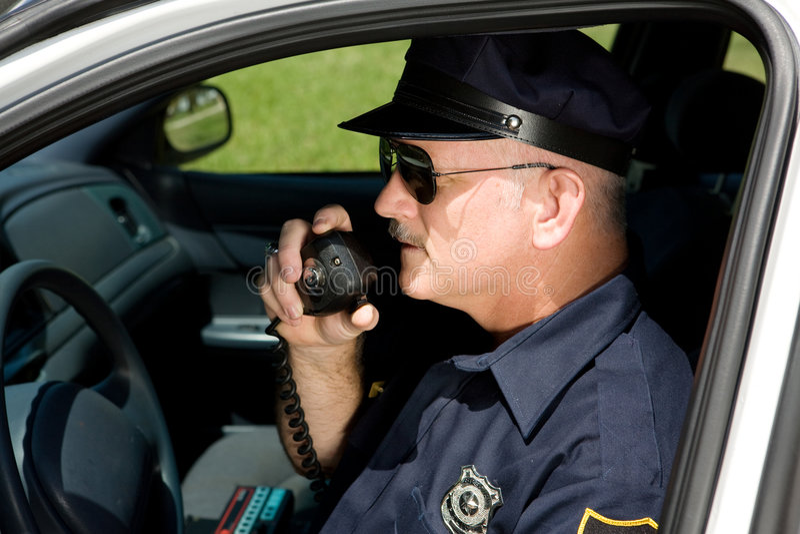 Politieman op Radio stock afbeelding
