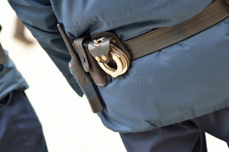 Politiemens Van Erachter Stock Foto