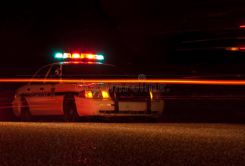 Politiewagen bij nacht royalty-vrije stock afbeeldingen