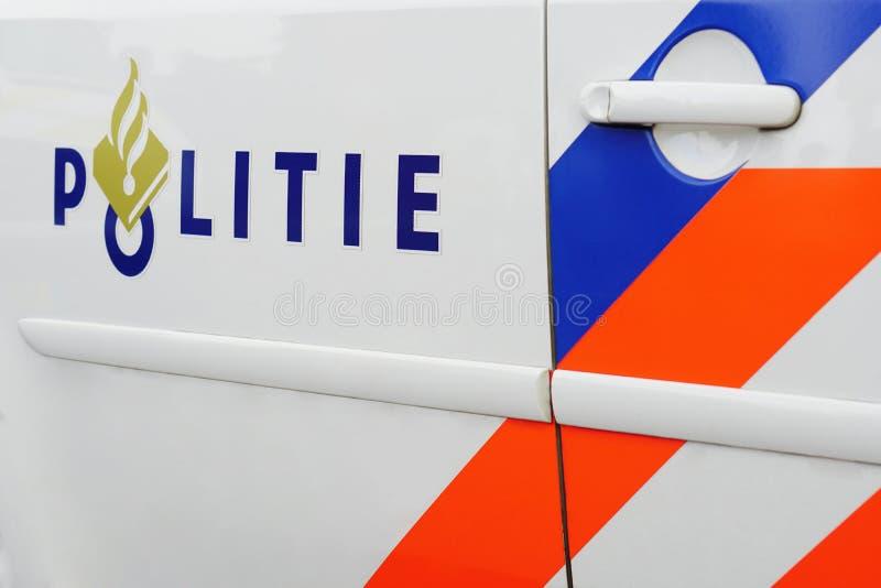 Politiewagen het Nederlands: Politie auto zijaanzicht stock afbeeldingen