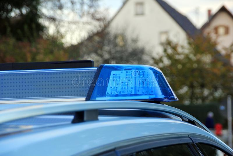 Politiewagen met blauwe lichte sirene royalty-vrije stock foto's