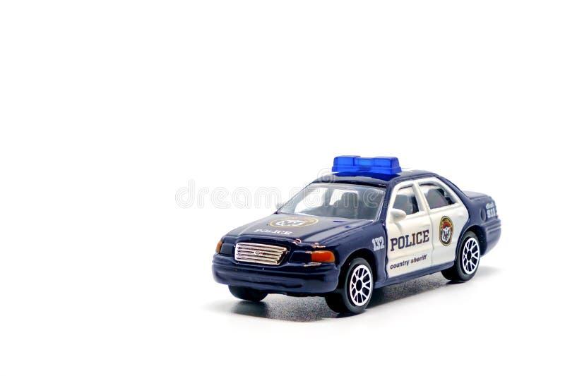 Politiewagenstuk speelgoed model op witte achtergrond royalty-vrije stock foto's