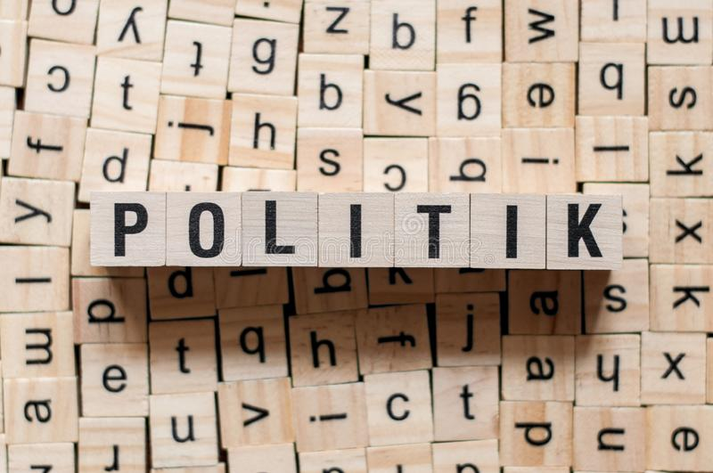 Politik - german text of POLITICS on cubes stock image