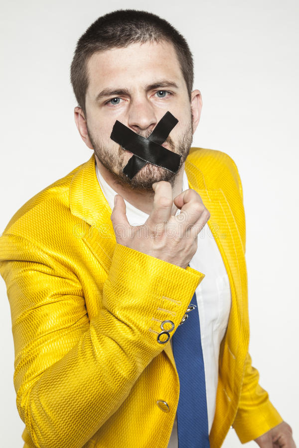 Politik skulle bryta bandet från hans mun arkivbilder
